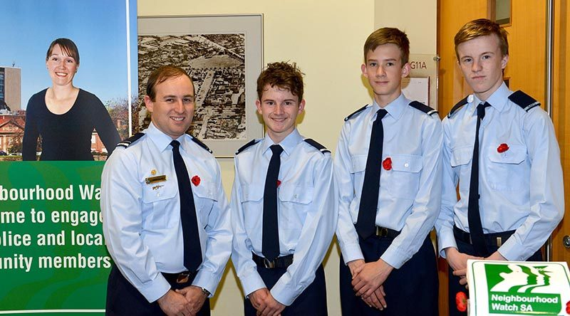Flying Officer (AAFC) Simon Blair, Commanding Officer of No 605 (City of Onkaparinga) Squadron with Cadets Darcy Needle, Ethan O'Connor and Joshua Duncan. Photo ourtesy of SA Police.