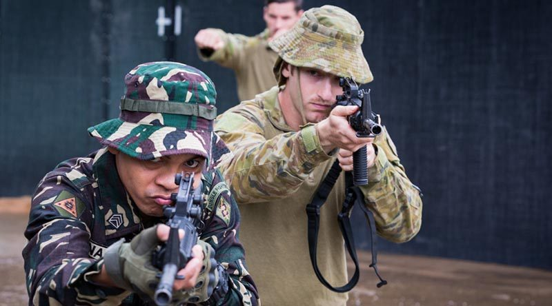 Philippine Army solider Sergeant Sonny Casuga practices urban combat techniques with Australian Army soldiers from the 3rd Brigade, at Capinpin, Philippines, as part of Operation Augury. Photo by Corporal Kyle Jenner.
