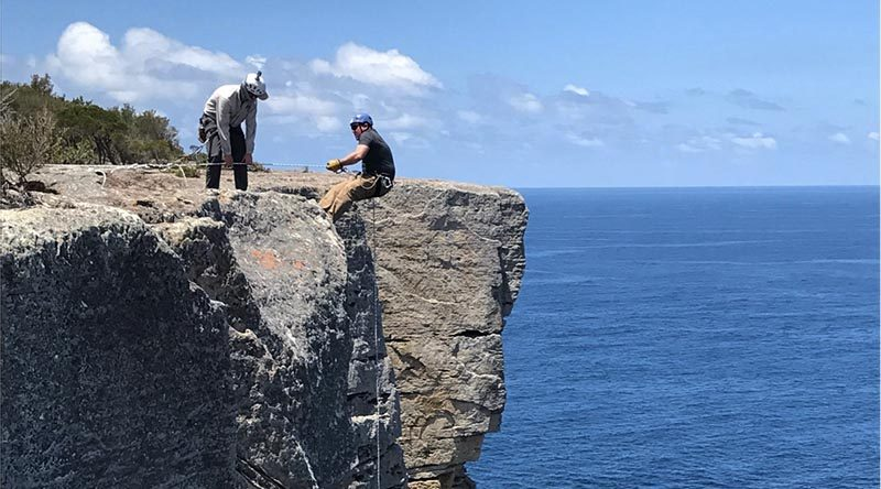Officer Commanding Adventurous Training Wing Major Dan Fussell encourages an Ex BB participant on an abseil.