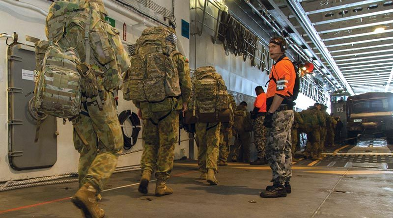Soldiers from 5 Brigade board one of HMAS Canberra's landing craft as they prepare to leave the ship on completion of Exercise Ocean Raider 2017.