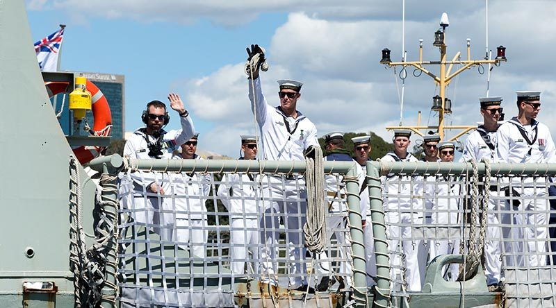 HMAS Newcastle' sailors wave to families as she pulls alongside Garden Island, Sydney after returning home from the Middle East Region. Photo (and caption) by Able Seaman Craig Walton.