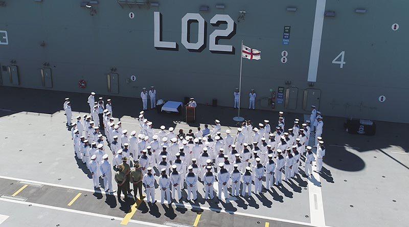 Commander Australian Fleet, Rear Admiral Stuart Mayer addresses a small gathering on-board HMAS Canberra before his handover as Commander, Australian Fleet to friend and colleague Rear Admiral Jonathan Mead. Photo by Able Seaman Tara Byrne.