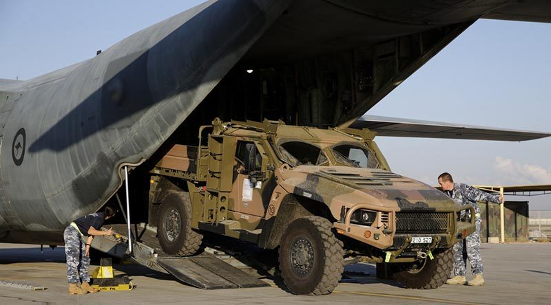 A Hawkei Protected Mobility Vehicle – Light, utility variant, is loaded into a Royal Australian Air Force C-130 Hercules at Australia's main base in the Middle East Region. Photo by Corporal Max Bree.