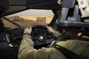 Private Daniel Harmer driving a Hawkei Protected Mobility Vehicle – Light at the Taji Military Complex, Iraq. Photos by Corporal Steve Duncan.