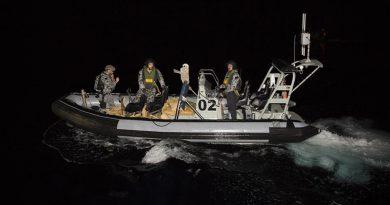 Leading Seaman Caleb Larnach, Able Seaman Eric Schneider and RNZN Leading Seaman Te Orangapumau Elia return to HMAS Warramunga carrying a load of seized narcotics. Photos by Leading Seaman Tom Gibson.