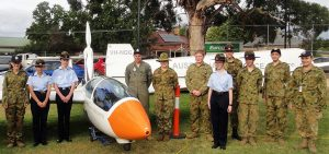 No 602 Squadron cadets on duty at the 2017 Mount Barker Show (left to right): CDT Grace Wilton, LCDT Anita Gardner, CCPL Benjamin Grillett, LCDT Ben Carter, CCPL Erika Gardner, CCPL Blake Harding, CDT Bianca Willsmore, LCDT Aiden Carling, CDT Lachlan Willsmore, CDT Kyle Bratkovic and CCPL Olivia Gardner. The ASK-21 Mi two-seater club glider is displayed with the propeller assembly raised to support self-launch or sustained flight.