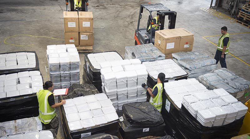 New Zealand Defence Force personnel prepare to load 12 tonnes of aid supplies for cyclone-hit Tonga. NZDF photo.