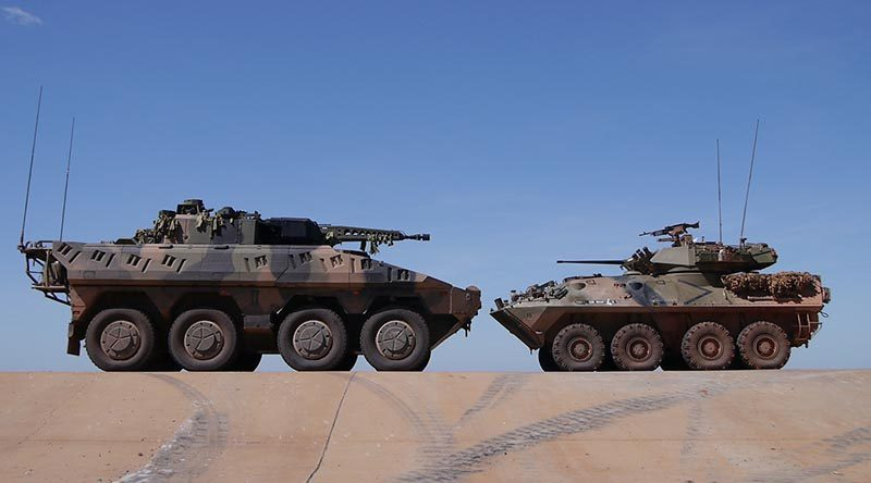 Rheinmetall Boxer CRV with an in-service Australian Light Armoured Vehicle (ASLAV).