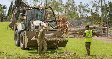 Members of 1st Combat Engineer Regiment from 1st Brigade, Darwin clean up Wulagi Primary School after Cyclone Marcus. Photo by Leading Seaman James Whittle.