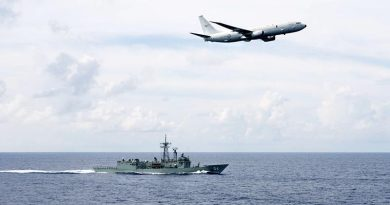 A RAAF P-8A Poseidon passes HMAS Darwin . Photo by Leading Seaman Peter Thompson.