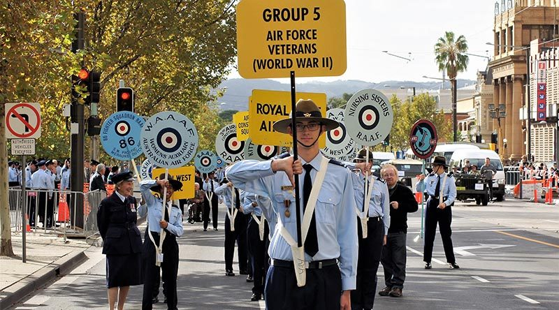 Leading Cadet Liam Mickan, No 613 Squadron, AAFC, carries the Banner at the head of the Air Force veterans of World War 2 for the Anzac Day march in Adelaide. He wore on his right breast the Zimbabwe Independence Medal awarded to his grandfather. Photo by Flying Officer (AAFC) Paul Rosenzweig.