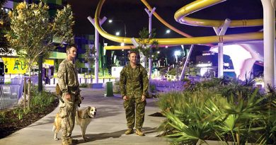 New Zealand Army Explosive Detection Dog Handler Acting Corporal Thomas Hynes (left) along with Australian Army 2nd Combat Engineer Regiment Sapper Guy Phillips, walk through the Athlete's Village, during a search of the venue for the 2018 Gold Coast Commonwealth Games. ADF photo.