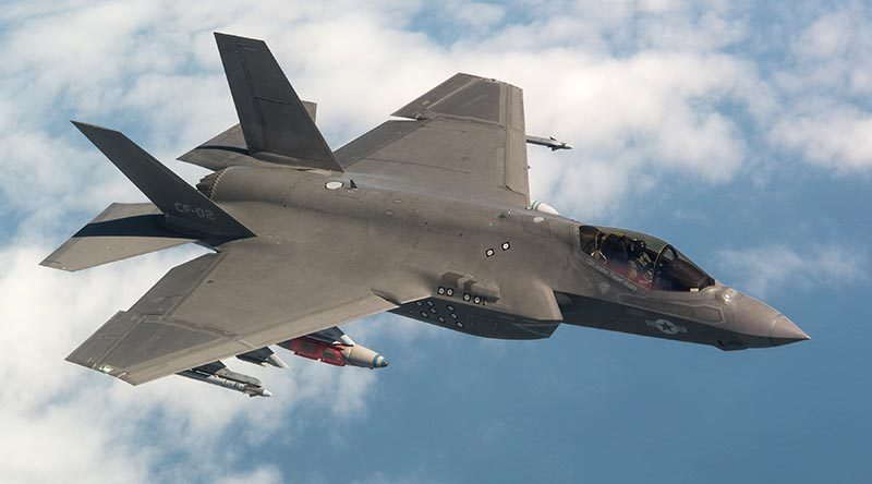 CF-02 Flt 596 piloted by Peter Wilson flies the final System Development and Demonstration (SDD) test flight for the F-35 program. Photo by Lockheed Martin.