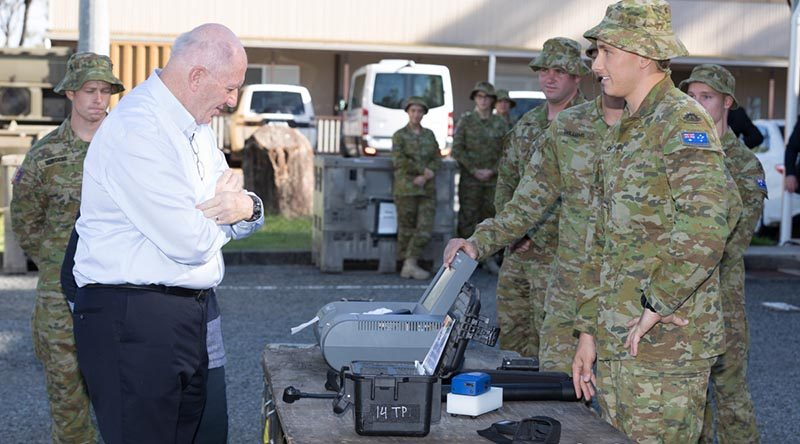 Australian soldier Sapper N Field of the 2nd Combat Engineer Regiment discusses search equipment with Governor-General Sir Peter Cosgrove and Lady Cosgrove at the Southport Army Depot. Photo by Sergeant David Hicks.
