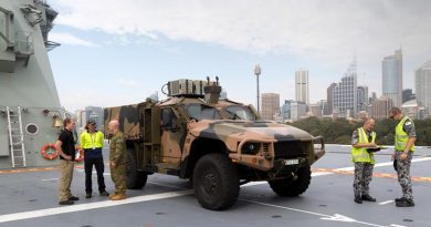 A Hawkei Protected Mobility Vehicle – Light on the flight deck of the Royal Australian Navy amphibious ship HMAS Adelaide during trials at Fleet Base East in Sydney. Photo by Leading Seaman Nicolas Gonzalez.