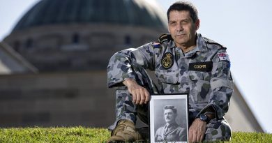 Royal Australian Navy Able Seaman Norman Cooper with a picture of his ancestor, Henry William 'Harry' Murray, VC, CMG, DSO and Bar, DCM, at the Australian War Memorial before going to Gallipoli for ANZAC Day 2018. Photo by Leading Seaman Jake Badior.