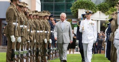 His Royal Highness Prince Charles walks with Commander of Australia's Federation Guard Lieutenant Commander Shannon Martin to inspect the Royal Guard at Old Government House, Brisbane. Photo by Leading Seaman Nadav Harel.
