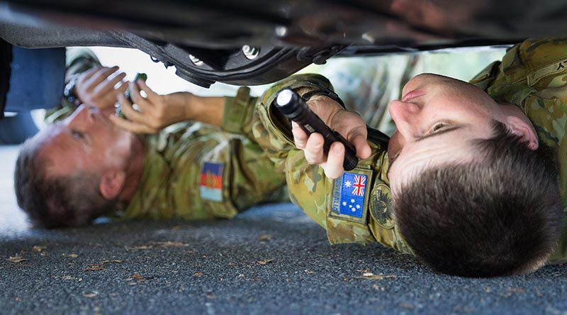 Australia Army Reserve soldiers Privates Zac Kelly (right) and Tony Duffy from 11 Brigade check underneath a vehicle during search training at Kokoda Barracks in preparation to support the security of the 2018 Gold Coast Commonwealth Games. Photo by Corporal Kyle Genner.