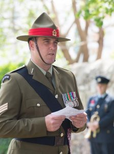 Sergeant Rory Lorimer delivers a reading at the service.