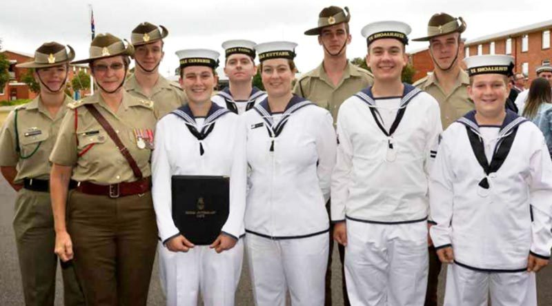 Seaman Siobhan von Prott, holding her graduation certificate, poses with, from left, Private Olivia Postlethwaite, mum Lieutenant Colonel Kim von Prott, brother (and Olivia's partner) Private Angus von Prott, Leading Seaman Dylan Waters (fiancé of Molly von Prott, one of the non-military family members), sister Seaman Alexandria Cunningham, brother Private Fearghus von Prott, brother Cadet Leading Seaman Ethan von Prott, brother Private Hamish von Prott, and brother Cadet Recruit Robert von Prott at her graduation ceremony at HMAS Cerberus. Absent is Alexandria's husband Leading Seaman Luke Cunningham, who sailed on HMAS Success the day the photo was taken.  Photo by Able Seaman Bonny Gassner Story by Corporal Sebastian Beurich