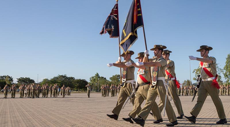 Soldiers from 1st Battalion, Royal Australian Regiment, parade the battalion Colours during Vietnam Week commemorations at Lavarack Barracks, Townsville (2016). Photo by Corporal Kyle Genner.