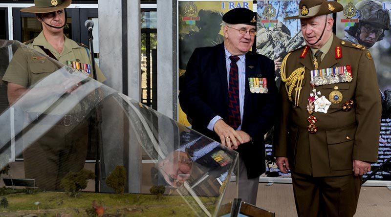 Bill Thurley shows Governor General of Australia General (Retd) Sir Peter Cosgrove a new diorama of the Battle of FSB Coral following a 50th anniversary parade at 1RAR. Photo by Major Al Green.