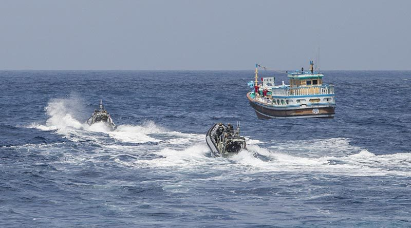 HMAS Warramunga crewmembers prepare to board a vessel suspected of carrying drugs. Photo by Leading Seaman Tom Gibson.