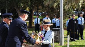 Wing Commander Mick Reidy, CO 462 Squadron, receives his floral tribute from Kelly Parkin of 613 Squadron AAFC, newly promoted to Cadet Corporal. Photo by Flying Officer (AAFC) Paul Rosenzweig.