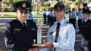 CCPL Nicholas Sibly accepts the Fieldcraft and Teamwork Competition from the OC 6 Wing on behalf of 601 Squadron.