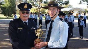 CSGT Benjamin Whiting (609 Squadron) receives the trophy for the Wing F-88 (WTSS) Team Shooting Competition.