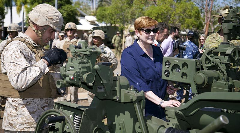 Minister for Defence Marise Payne looks over a M777 howitzer in company with an artillery marine from Marine Rotation Force - Darwin, during a visit to Robertson Barracks, Darwin. Photo by Leading Seaman James Whittle.