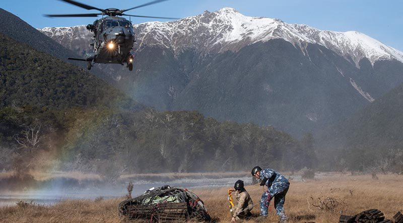 Personnel from the New Zealand Army's 5 Movements Company and the Royal New Zealand Air Force's No.3 Squadron remove debris from Travers Valley in Nelson Lakes National Park, in support of the Department of Conservation. NZDF photo.