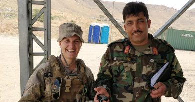 Captain Demi Exley and and un-named Afghan mentee at Camp Qargha, Afghanistan. NZDF photo.