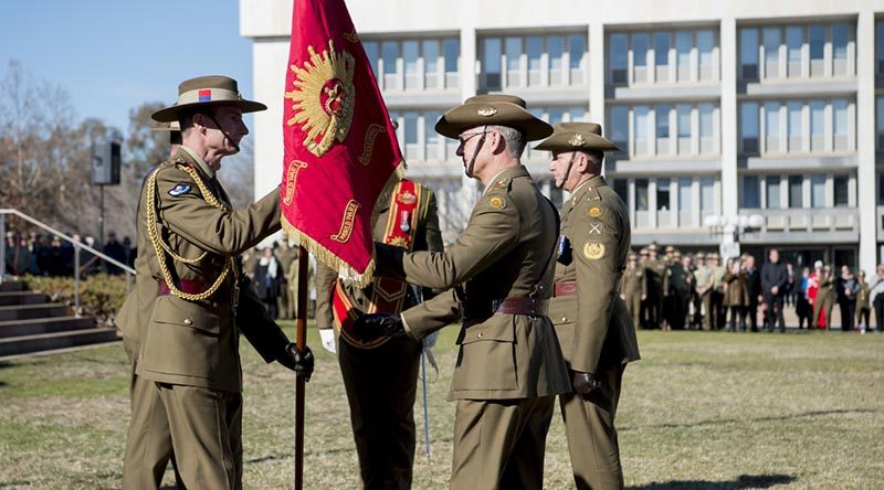 Outgoing Chief of Army Lieutenant General Angus Campbell passes the Army Banner to incoming Chief of Army Lieutenant General Rick Burr during a Chief of Army handover parade at Russell Offices in Canberra. Photo by Grace Costa Banson.
