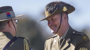 Outgoing Regimental Sergeant Major - Army Warrant Officer Don Spinks, congratulates incoming Chief of Army Lieutenant General Rick Burr during a change-of-command parade in Canberra. Photo by Corporal Tristan Kennedy.