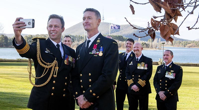 Chief of Navy Vice Admiral Michael Noonan takes a selfie with Chief Petty Officer Troy Eather at Government House, Canberra, after the presentation of bravery medals and awards for Australian Thai cave rescuers. Photo by Lieutenant Tony Martin.
