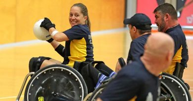 Australian Invictus Games 2018 team member Trudi Lines prepares to pass during a wheelchair rugby exhibition match with RSLWA, in Perth. Photo by Leading Seaman Jason Tufrey