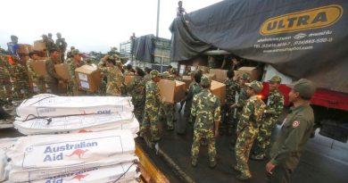 Laos Army personnel unload Australian Humanitarian Aid pallets that have been delivered to Pakse International Airport by a No. 36 Squadron C-17A Globemaster. Photo by Corporal Colin Dadd.