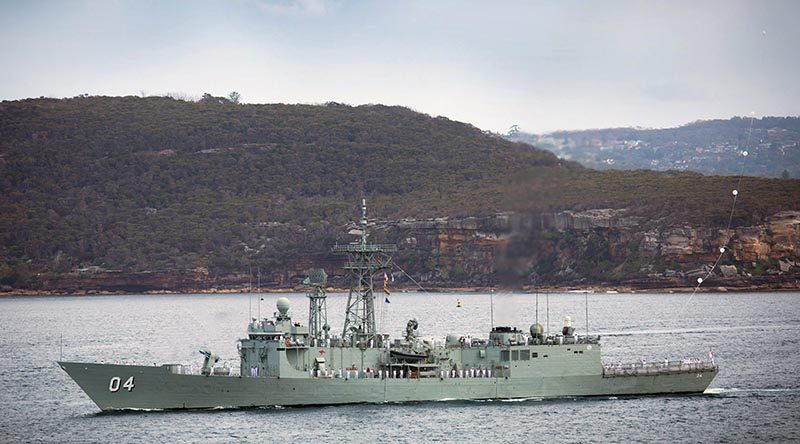 HMAS Darwin sails through Sydney Heads for the final time before decommissioning. Photo by Able Seaman Tara Byrne.