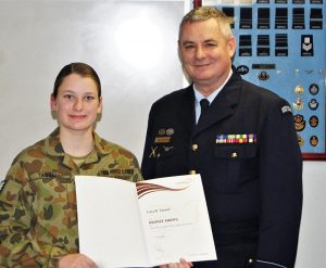 In the same ceremony, CCPL Lucy Tassell received her Bronze Duke of Edinburgh's Award badge and certificate from 6 Wing Public Affairs & Communication Officer FLGOFF(AAFC) Paul Rosenzweig.