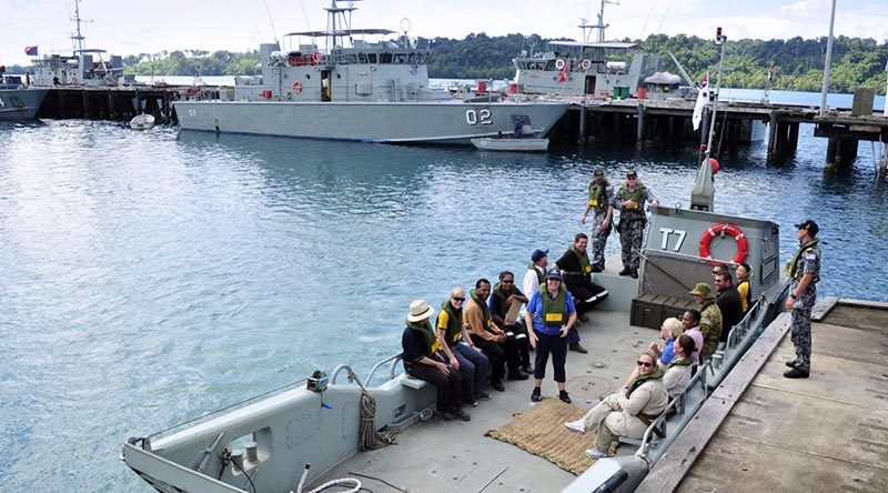 Manus Island Regional Processing Centre (MIRPC) staff board an Australian landing craft Lombrum Naval Base, Manus Island. Photo by Sergeant W Guthrie.