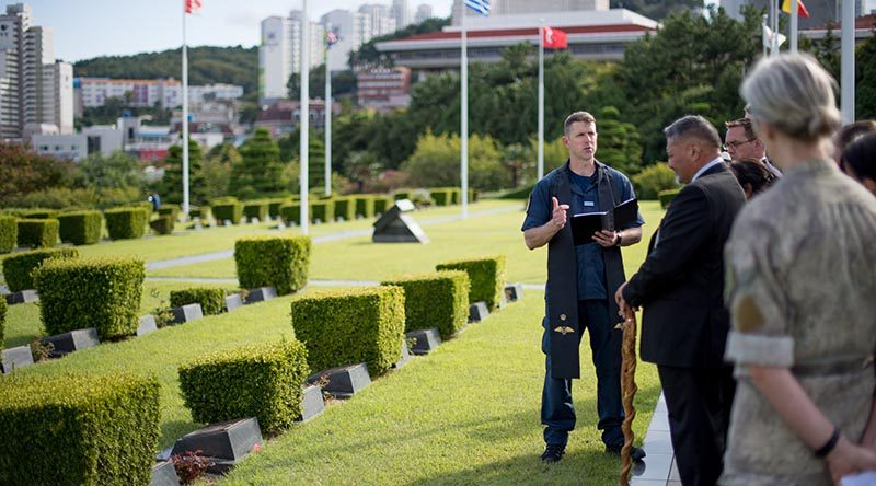 Chaplain Class 4 Russell Bone delivers a prayer in the United Nations Military Cemetary in Busan, Korea, to start the process of disinterring the bodies of two New Zealand service personnel who died and were buried in Korea. NZDF photo.