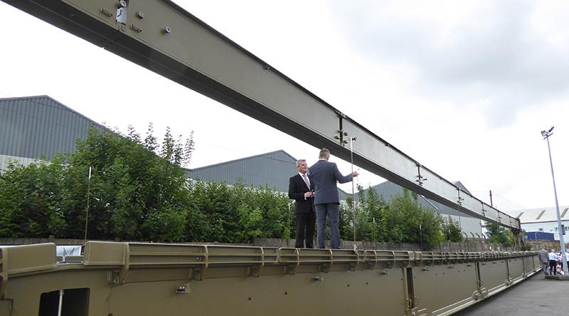 British VIPs examine a WFEL dry support bridge ready for shipment to the Australian Army. WFEL photo.