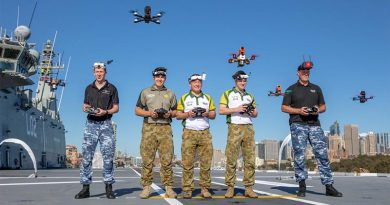 Drone racers, RAAF Officer Cadet Nicholas Eberl, Australian Army members Private Mackenzie Togo, Lieutenant Mark Sheppard and Lieutenant Thomas Gash, and RAAF Flight Sergeant Justin Galbraith, hover their drones over the flight deck of HMAS Canberra, to promote the inaugural Military International Drone Racing Tournament in the lead-up to Invictus Games. Photo by Able Seaman Leo Baumgartner.