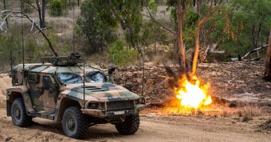 A simulated munition explodes next to an Australian Army Hawkei Protected Mobility Vehicle – Light during Land Trial 02-18 at the Townsville Field Training Area in north Queensland. Photo by Corporal Nunu Campos.
