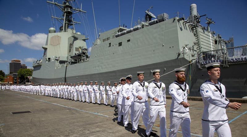 The commissioning crew of HMAS Brisbane march on to their new ship during a ceremony at Fleet Base East. Photo by Leading Seaman Nicolas Gonzalez.