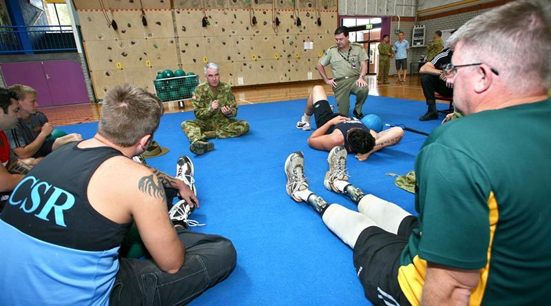 Then Chief of Army Lieutenant General Ken Gillespie and Commander Joint Health Command Major General Paul Alexander chat with participants in the ADF Paralympic Sports Program. Photo by Sergeant Brian Hartigan.