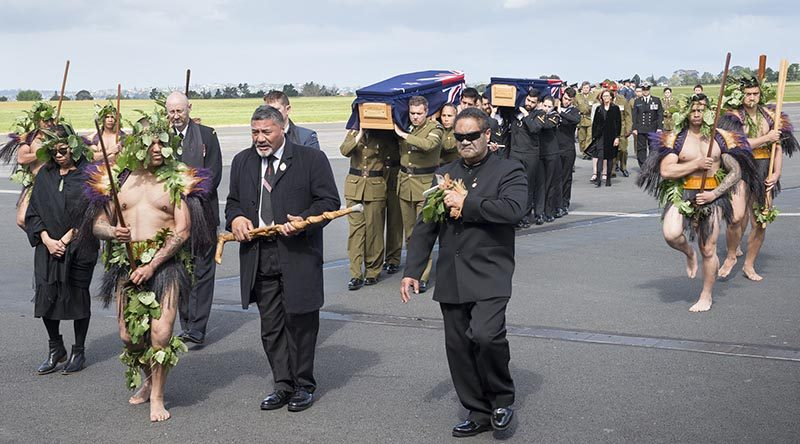 A he taua (war party) leads the caskets of Peter James Mollison, a Royal New Zealand Navy telegraphist, and Herbert Lester Humm, a driver with 10 Transport Company, New Zealand Army, who lost their lives in Korea more than 50 years ago, and where returned to family in New Zealand. NZDF photo.