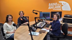 CSGT Tegan Thomas (622 Squadron), left, and CCPL Erika Gardner (602 Squadron) in the Radio Adelaide studio with Ms Helen Meyer, Executive Producer of 'Service Voices – service to country, service to community'. Photo by Flying Officer (AAFC) Paul Rosenzweig.