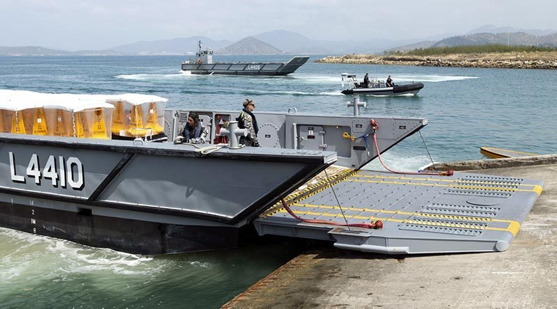 Royal Australian Navy landing craft unload marker buoys at HMPNG Basilisk Naval Base, Port Moresby, in support of APEC. Photo by Able Seaman Kieran Whiteley.